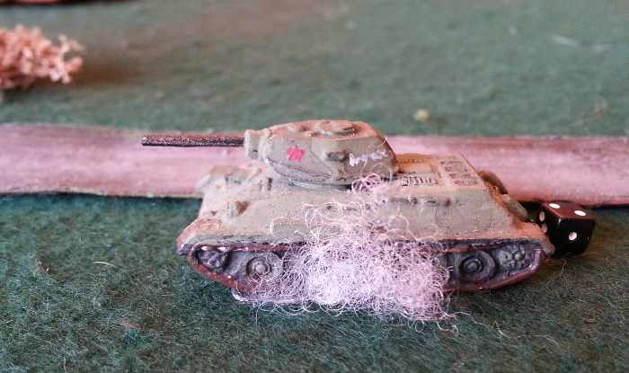( an immobilized T-34, another one was K.O.  .. and the third ... )
