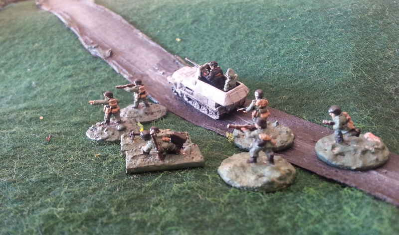 ( after a close miss, my men came out of the half track, while the crew tried to drive it to the village, where the main attack was expected )