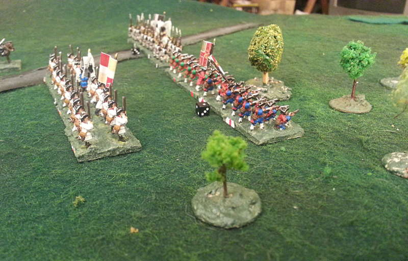 ( On my left flank, the soldiers still advanced, despite some artillery fire.)