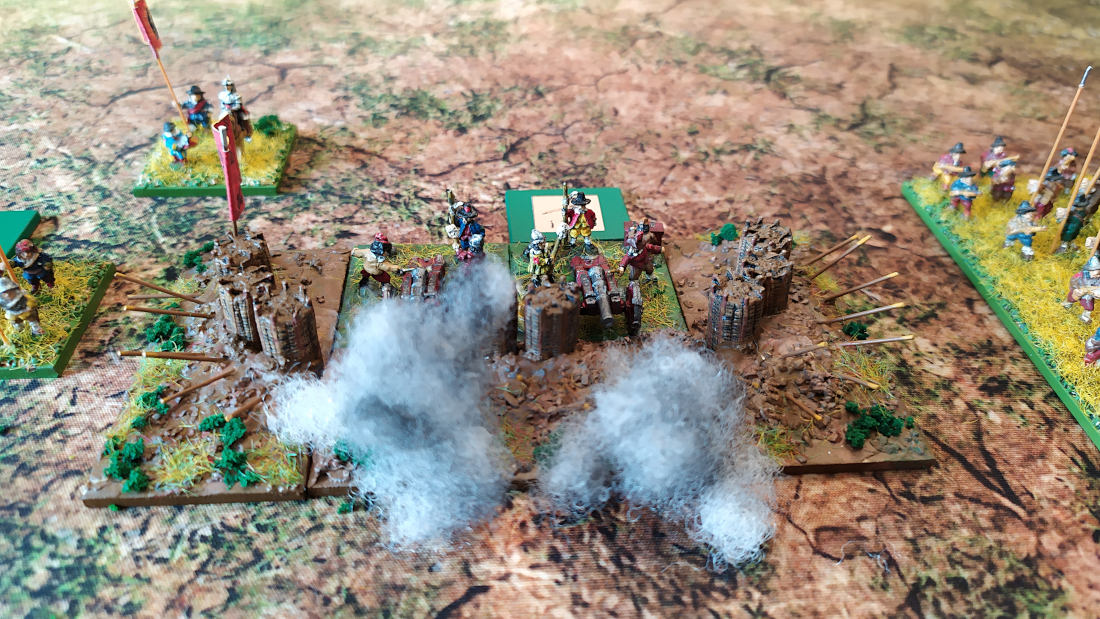 ( The spanish artillery opened fire, locking the very open terrain in tne center )
